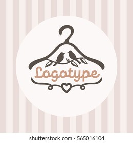 Logo for baby clothes shop with a picture hanger and sitting birds.