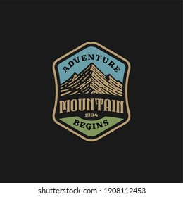 logo badge of mountain and adventure in vintage design.