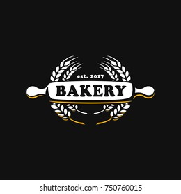 The logo of the bakery for bakeries, rolling pin, a rocking roll is depicted, and around the stalks. Baking, Cafe, Shop, Fast Food. Vector illustration logo