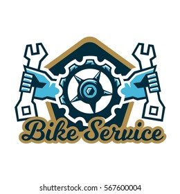 Logo bike service. A bicycle sprocket and hand holding a wrench on the sides. Repair, Tune mountain bike. Vector illustration. Flat style