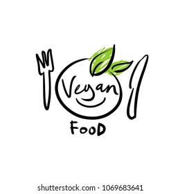 Logo with the designation of Vegan. The image of a plate and edible leaves.