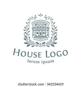 Logo emblem with the house. White background.