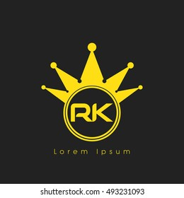 Logo letters R and K yellow crowned. Crown logotype design template on black background