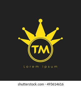 Logo letters T and M yellow crowned. Crown logotype design template on black background