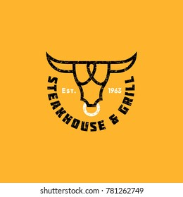 Logo steak house. Meat restaurant or butchery emblems. The stylized head of a bull and letters.