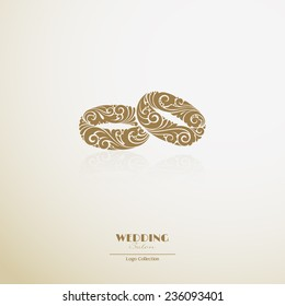 Logo wedding salon. Ornate couple of rings icon