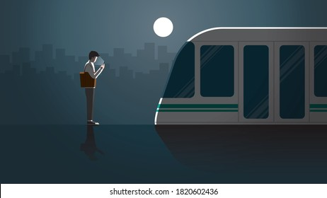 Lonely office man first jobber use smart phone waiting in public transportation station for last train at night alone in the dark and full moon light. City lifestyle of work late overtime and overwork