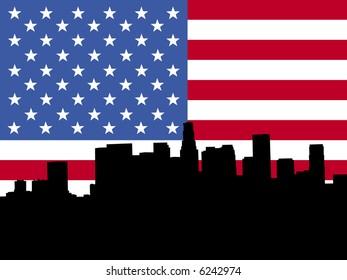 Los Angeles skyline viewed from Hollywood Boulevard against American flag