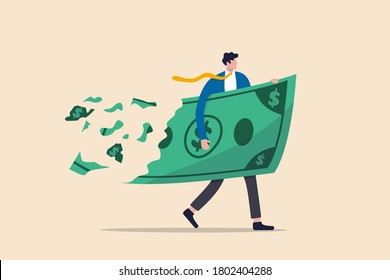 Lose money investment in financial crisis, profit and loss in business or deflation and inflation concept, businessman holding big dollar banknote money while loss, crumble and reduce in value.
