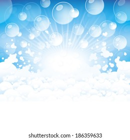 Lots of foam and transparent bubbles on a blue background.