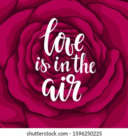 love is in the air. Hand drawn brush pen lettering on background flower red rose. design holiday greeting card and invitation of wedding, Happy mother day, birthday, Valentine s day and holiday