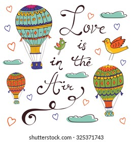 Love is in the air. Hand drawn card with air ballooons and handwritten words