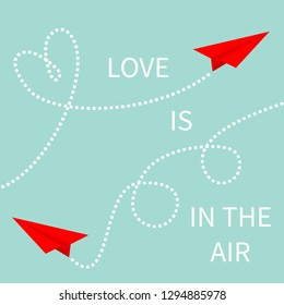 Love is in the air. Two red flying origami paper plane set. Dashed line. Heart loop. Happy Valentines day. Greeting card Typographical blue sky background with quote. Flat design. Vector illustration