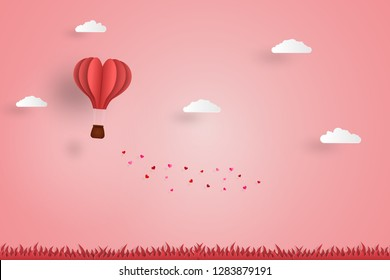 love concept,heart design hot air balloon on pink background. paper art design for valentine day