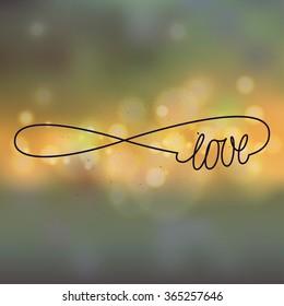 love forever handwriting sign. bokeh lights background.