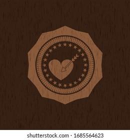 love icon inside vintage wooden emblem