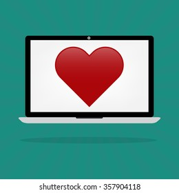 Love red hearts on laptop computer internet online dating concept.