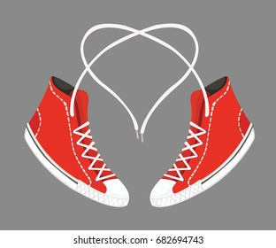 Love of sneakers. Red sneakers with heart shaped shoelaces.