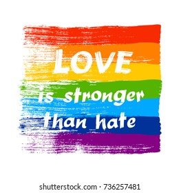 Love is stronger than hate - LGBT pride slogan against homosexual discrimination. Modern calligraphy on rainbow grunge flag. Vector illustration.