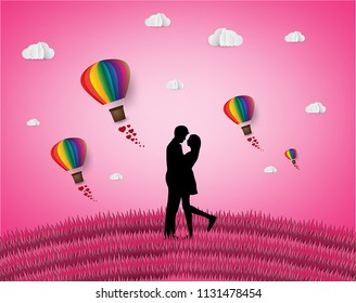 Love and Valentine day,Lovers stand in the meadows and a paper art heart shape balloon floating in the sky. craft style.
