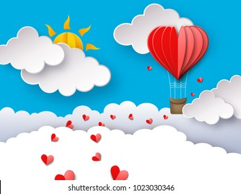 Love or Valentine's day background with heart shaped hot air balloon flying through clouds. Romantic paper art and origami style vector illustration