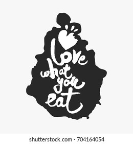 Love What You Eat. Hand written calligraphy phrase in an ink blot. White on black. Clipping paths included.
