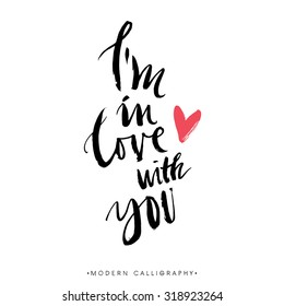 I'm in love with you. Modern brush calligraphy. Handwritten ink lettering. Hand drawn design elements.