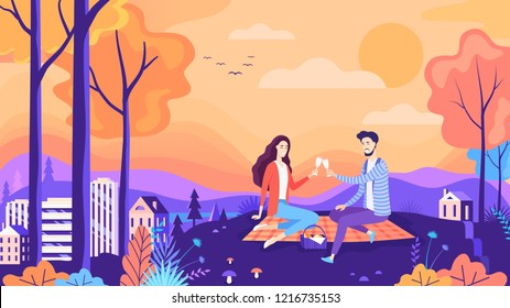 Lovely autumn picnic couple in the city park. Beautiful nature