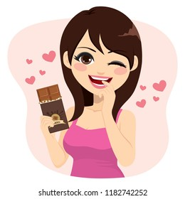 Lovely brunette woman eating chocolate bar naughty face expression