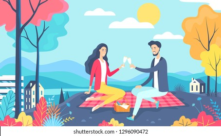 Lovely couple have a date picnic in the city park. Happy Valentine's day