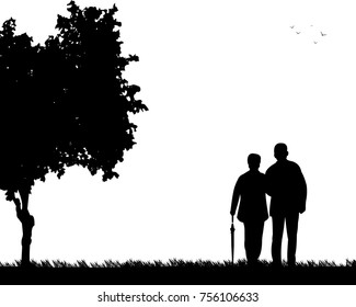 Lovely retired elderly couple walking with umbrella in park in autumn or fall, one in the series of similar images silhouette