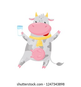 Lovely spotted cow with golden bell holding glass of milk, funny farm animal cartoon character vector Illustration on a white background