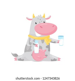 Lovely spotted cow sitting and holding bottle and glass of milk, funny farm animal cartoon character vector Illustration on a white background