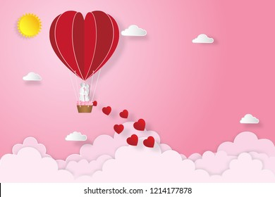 The lover in hot air balloons on pink sky and sunrise background as love , wedding, valentine, design paper art , cut and craft style concept. vector illustration