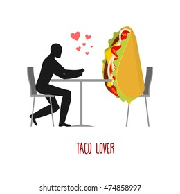 Lover taco. Lovers in cafe. Man and fastfood sitting at table. Mexican food in restaurant. Romantic date in public place.