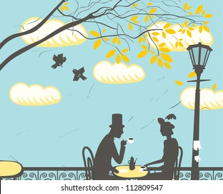 loving couple in a city cafe in the clouds