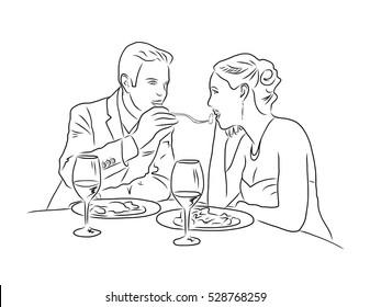 Loving couple in restaurant.