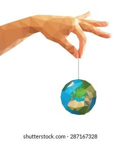 low poly polygon left hand holding a globe with his thumb and index finger.