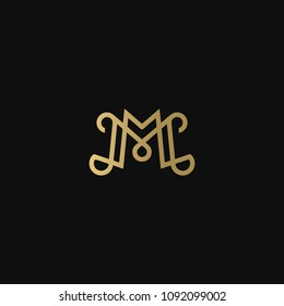 Luxurious modern elegant fashion brands M MM black and golden color initial based letter icon logo.