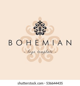 Luxury bohemian logotype in the shape of a flower for antique boutique or classic bakery. Pastel colors, flower. Simple geometric sign. Icons, business, invitations.  Vintage, Baroque, Retro.