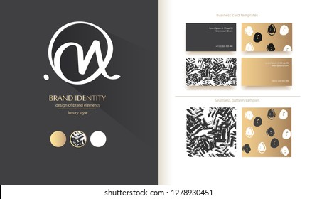 """Luxury brand line logo with calligraphic uppercase O and lowercase m or n letters forming """"Om"""". Classic style branding templates. Business cards and used seamless patterns included - Vector"""