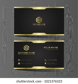 Luxury and elegant black gold business cards template on black background.
