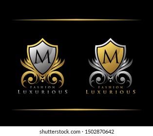 Luxury Gold Shield M Letter Logo Icon. Classy shield icon.
