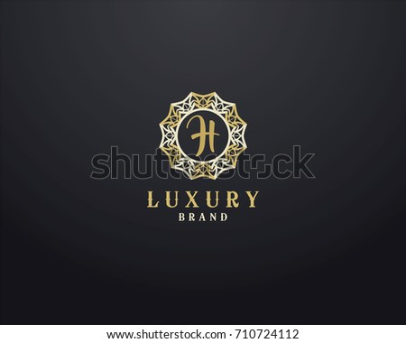 2818e114fe8 Luxury letter H monogram vector logo design. mandala and ornamental logo.