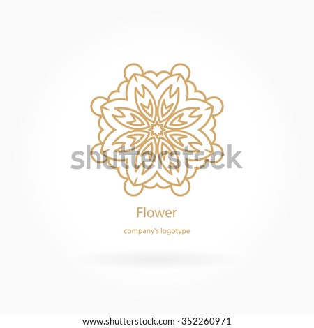 luxury logotype in the shape of a flower for antique boutique gold logo flower