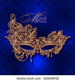 Luxury ornate golden carnival mask Mardi Gras on a blue background. Vector illustration.