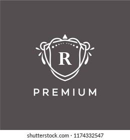 Luxury R Initial Logo frame symbol, Luxury and graceful floral monogram design dark background