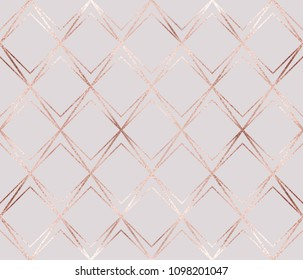 Luxury rose gold geometric seamless pattern with rhombuses tiles.