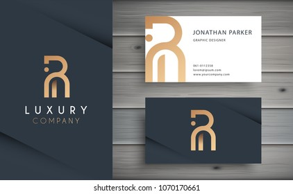 Luxury vector logotype with business card template. Premium letter R logo with golden design. Elegant corporate identity.