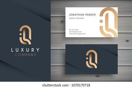 Luxury vector logotype with business card template. Premium letter Q logo with golden design. Elegant corporate identity.